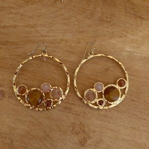 Gold earrings with tan and pink stones